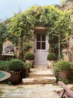 French country.  OMG.  I would love to have this in my backyard.  Hopefully those plants don't require my help to stay alive.  Or they would be considerably browner.