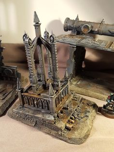 The omnipresent Warhammer 40K pieces. I woncder if an 'inverted' cathedral design (with the buttresses inside the room) would look good in a big room with large windows. The height of the room could be a problem, however...