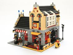 This is a perfect simple street corner.  Love the scale, gate to alleyway, and the use of pretty old Legos!