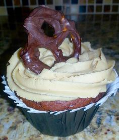 Chocolate Salted Caramel cupcakes with pretzels drizzled with homemade caramel and hand dipped in semi-sweet chocolate and caramel buttercream frosting ~Diane