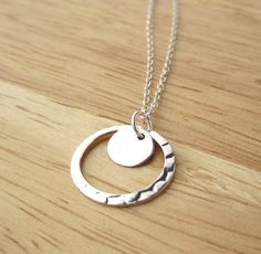 Must have for simple jewelry lovers! Sterling Silver Hammered Ring and Tiny Disc Necklace by Yameyu, $24.50 http://www.etsy.com/listing/98432929/sterling-silver-hammered-circle-ring-and