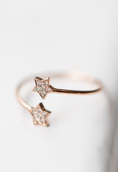 ANNA Ring MERCURY Two Stars in 18 ct. Rose Gold with 12 White Diamonds 0.06 ct.