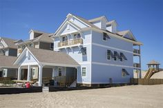 SUNRISE OASIS, #834 | Nags Head, NC - Outer Banks Wedding and Event Home l Oceanfront and newly constructed in 2015, this home provides 8 master suites, elevator, theater lounge, recreation lounge with sports bar, oceanside sitting lounge, heated pool, hot tub, covered outdoor bar, cabana bath, private beach walkway and dune-top gazebo. l www.CarolinaDesigns