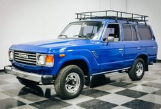 1987 FJ60 Land Cruiser The FJ60 is one of the most capable, reliable, and downright handsome 4x4s ever produced. This one features a purposeful safari rack, fresh coat of paint, and some new upholstery. At a mere 281,000 miles, it's just getting broken in.