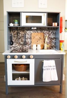 Play Kitchen Renovation - DIY Ikea Duktig Hack - by Cassie at The Inspired Room.possibly build a fridge too. Play Kitchen Diy, Ikea Kids Kitchen, Pretend Kitchen, Toy Kitchen, Play Kitchens, Kitchen Racks, Decor Inspiration, Kitchen Remodel, Kitchen Design