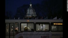 People sleep inside a Metrobus parked at Union Station in Washington on January 22. The bus was designated a warming station for the homeles...