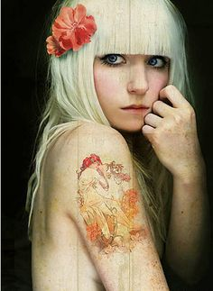 I have this tattoo on the opposite arm in black and grey.. Hands down my favorite artist of all time.. Major props to Alphonse Mucha.