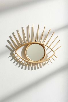 """Mirror width: 8"""",  Height: 14"""" Rattan, glass  Magical Thinking Open Eye Mirror - Urban Outfitters"""