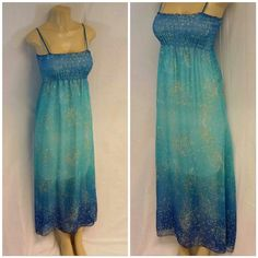 """Blue Sheer Half Lined Floral Summer Dress Small Blue, Sheer, Half Lined, Floral Summer Dress, size Small, elastic bodice, adjustable straps, half lined in white (shown in pictures), 55% linen, 45% polyester, 51"""" approximate length shoulder to hem, bust stretches to 16"""" laying flat Dresses"""