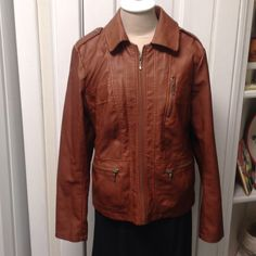 Jacket. It was given  to me , soft like leather , Brown leather like material  with zippers on pockets ,it's 25 in long  sleeves 31 in long labels have cut out but it fits me like a med. I'm 5/7 129 lbs  lined with satin like material Jackets & Coats