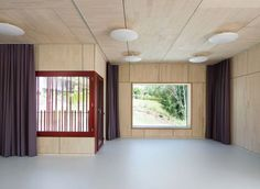 Double Kindergarten in Switzerland designed by Singer Baenziger Architects | curtain tracks around walls and on ceiling to partition space