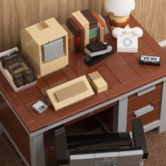 the nostalgia-inducing sets include colored swivel chairs and a huge range of mini-models to arrange on the desktop.