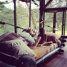 bed... Such cool sheets!  My dream bedroom, but i think i would get a bit scared at night because of all the windows