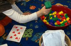 Math using number cards,salad grabbers and colored bears.