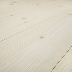 These bright, fresh pine floors are treated with stain and varnish. The varnish has a matt finish that creates the soft feeling of an oiled floor.