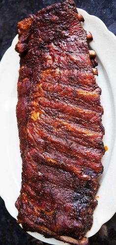 Memphis-style dry rubbed pork ribs barbecued slowly to perfection! Perfect for a July 4th BBQ