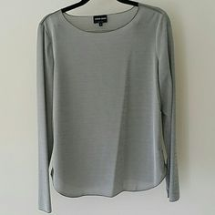 Giorgio Armani long sleeve top Never worn, authentic Giorgio Armani long sleeve top. Has a silky. Jacquard feel to the fabric and super comfortable. Fits true to size. Material is made out of 70% Polyamide, 25% Polyester and 5% Elastin. Giorgio Armani Tops Tees - Long Sleeve