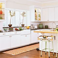 White cabinetry and tile give this kitchen a light and airy look as timeless as the sea | Coastalliving.com