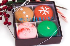 A great gift box of our Gingerbread, Merry Cherry, Candy Cane, & Spicy Chocolate macarons