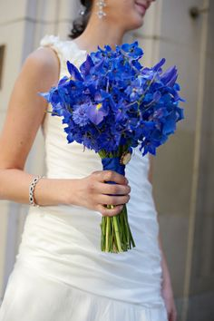 """Nice hand-tied bouquet featuring delphinium, hydrangea, centaurea and iris. Created by Christopher Flowers."" - Blue bouquet"