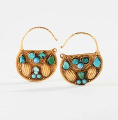 Saudi Arabia | Pair of earrings; 14k gold with turquoise | From the Bedouin women in the Najd region | 500€ ~ sold (Feb '14)