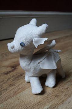 want!!!! *** White Dragon Plushie. via Etsy.