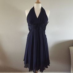 Maggy London Silk Cocktail Dress Beautiful dark blue halter style dress made in 100% silk. NWT Never worn. Maggy London Dresses