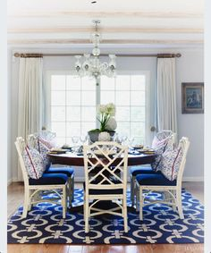 Yes. Want a rug with blue and white, white chairs with blue cushion, and longer table with rustic top