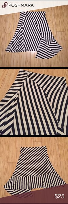 Black and White Stripped Skirt Black and white stripped skirt. Falls at different levels. Asymmetrical type. 94% acrylic, 6% spandex. Only worn once. Feel free to make an offer. Necessary Objects Skirts