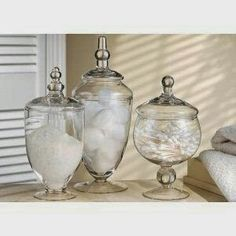 Glass jars on vanity with cotton wool & ear buds