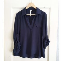 Flowy Top Cute flowy top. Collared with roll up sleeves and navy in color. Good condition. Originally purchased from Nordstrom. No Trades Tops Blouses