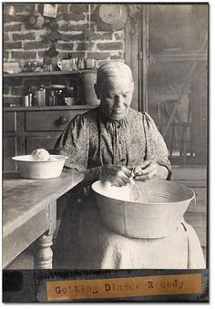 Photo: Domestic servant getting dinner ready,1906