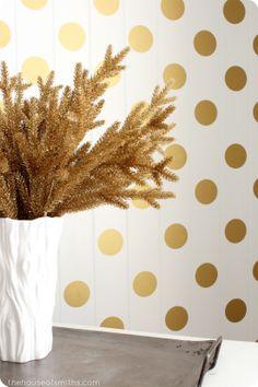 Gold polka dots on wall + gold Christmas decor - thehouseofsmiths.com