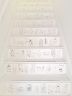 the stairs collaged with my kids' drawings