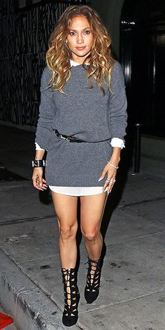 We've always loved the polish of a white collared shirt under a crewneck sweater, and J.Lo gives us a fresh way to sport the look: in dress form. Belting the layered pieces and accessorizing with badass lace-up boots balances out the primness and properness of the look.