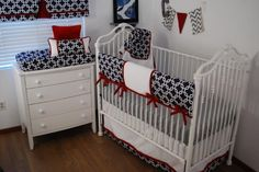 Navy Squares print fabric with red and white in the nursery