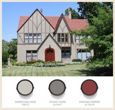Tudor Style home with tone on tone neutrals and a bright red door.