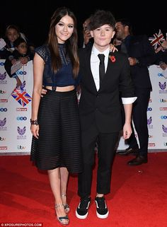 Young love: As weekly performances on ITV juggernaut The X Factor inevitably bring in their wake a flurry of public appearances, new couple Emily Middlemas and Ryan Lawrie made their biggest yet at the Pride of Britain Awards on Monday evening