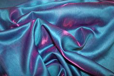 Turquoise/Purple Iridescent Satin Back Dupion    Made in Japan    135cm wide    This fabric is cross dyed. This means the fabric is woven one way with one colour and the opposite way with another shade    Please note the first colour stated is always the leading and prodominant shade    £6.99 per metre
