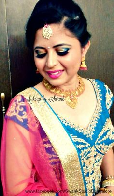 Our client Namitha is all dolled up for her brother's reception ceremony. Makeup and hairstyle by Swank Studio. Smokey eye. Pink lips. Jhumkis. Designer lehenga. Gold jewellery. Maang tikka. Hairstyle. Find us https://www.facebook.com/SwankStudioBangalore