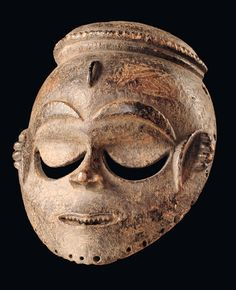 "Africa | Mask from the Eket people of Nigeria | Wood, with dark brown encrusted patina | These masks were used by the ""ekpo"" society during the planting and harvesting of yam."
