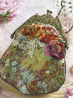 Crazy quilted purse... wonder how they made those velvety looking flowers!