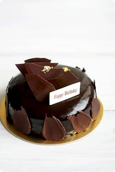 Chocolate, Hazelnut Prailine Brittle, Lemon Curd Mousse Cake with Chocolate Lacquer Glaze.