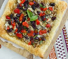 Caramelized Onion & Eggplant Puff Pastry Tart with Kalamata Olives, Roasted Red Peppers & Basil