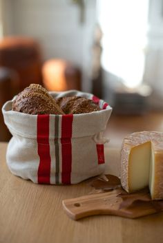 Here's a lovely gift for that friend who always has homemade rolls on the dinner table: a bread basket from the Basque region of France. This soft fabric bag holds a secret, too: it has a pouch of cherrystones in the base. Heat this in the microwave and the bag will keep your bread or rolls gently warmed at the table. Comes in red, black, ecru, and blue.
