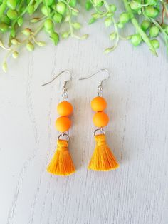 These striking Orange Tassel Earrings are the perfect statement tassels to your neutral outfit! Get these pair of simple yet absolutely gorgeous hypoallergenic earrings and add them to your earrings collection. Tassel Earing, Anniversary Gifts For Wife, Orange Earrings, Neutral Outfit, Earrings Handmade, Handmade Jewelry, Beautiful Earrings, Jewelry Trends, Absolutely Gorgeous