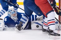 Toronto Maple Leafs goalie James Reimer (34) makes a save against the Columbus Blue Jackets during the first period of an NHL hockey game in Toronto, Wednesday, Jan. 13, 2016. (Nathan Denette/The Canadian Press via AP)