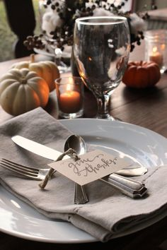 Thanksgiving table with hand lettered cards and cotton arrangement