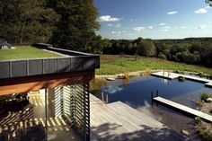 This beautiful house features an in-ground pool/pond hybrid with swim decks