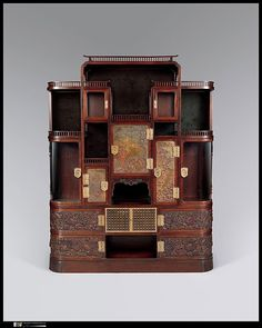 American Gilded Age furniture makers, and interior designer's: Herter Brothers, NYC. Pictured here one of their late 19th century ornate cabinet's. ~ {cwl} ~~ (Image: Luxury Listings NYC)